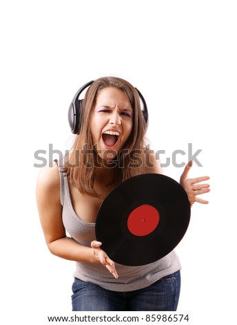 Excited girl signing with vinyl disc in hands isolated on white