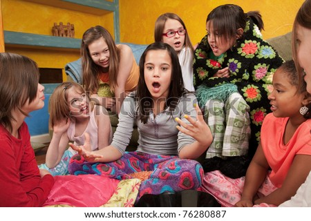 Excited girl talking with her friends at a sleepover
