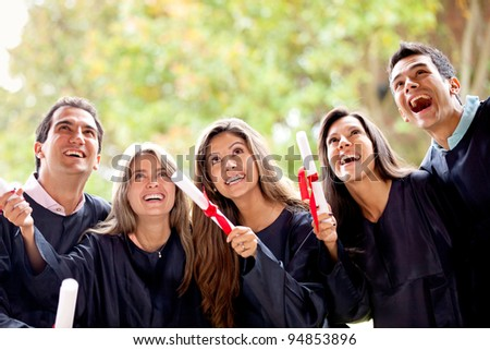 Excited group of friends on their graduation day