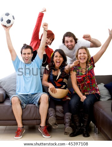Excited group of people watching football at home