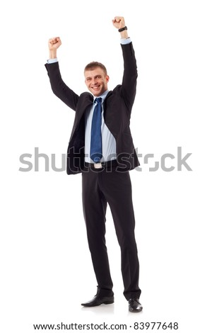 Excited handsome business man with arms raised in success - Isolated on white - stock photo