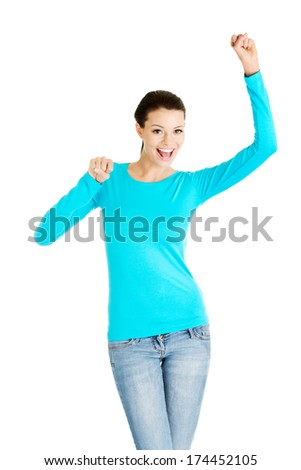 Excited happy success young woman with fists up, isolated