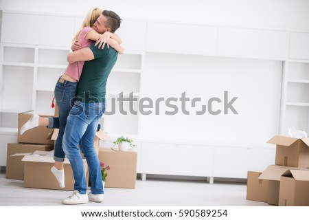 excited happy young couple looking forward to moving into a new home #590589254