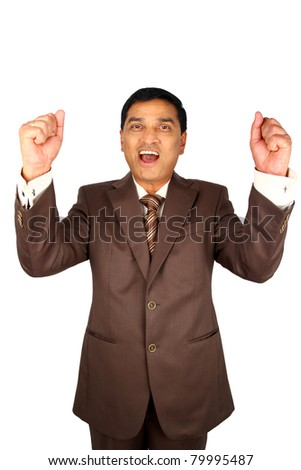 Excited Indian businessman rasing his arms joyfully. Isolated on white.