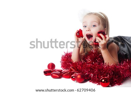 excited little girl with new year toys isolated