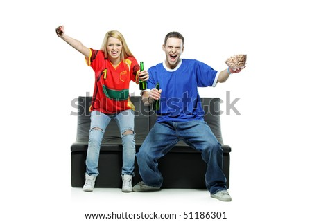Excited man and woman watching sport isolated on white background - stock photo