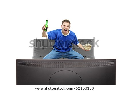 Excited man watching sport on a TV isolated on white background
