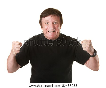 Excited mature Caucasian man holds fists in the air