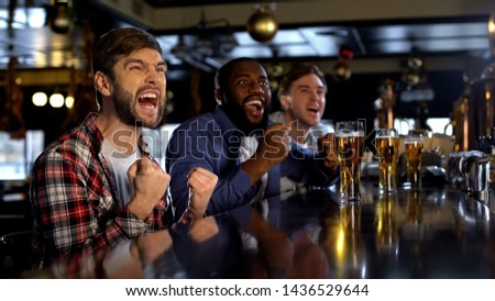 Excited multiethnic friends supporting sports team, victory of national team