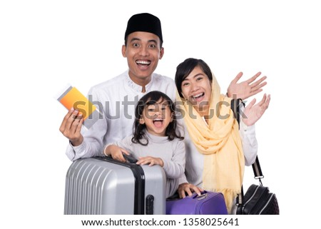 excited muslim family with suitcase and passport travelling for eid mubarak celebration