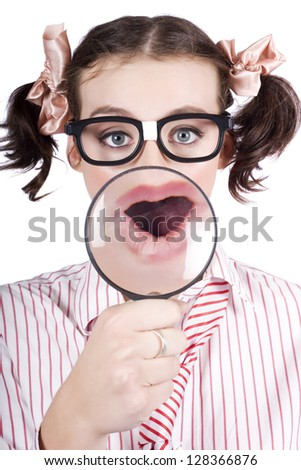 Excited Nerdy Female Businesswoman Looking Shocked With Magnifying Glass When Discovering The Truth To A Business Puzzle