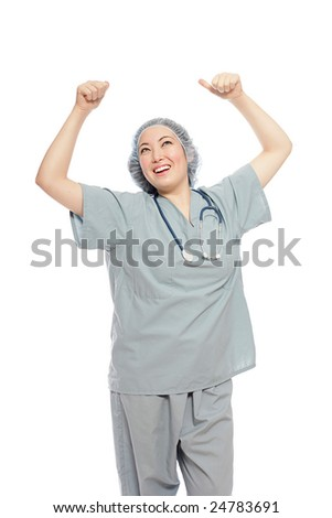 Excited nurse in scrubs and surgical cap with raised arms