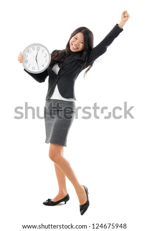 Excited Office Lady off work at 5pm. Full body Southeast Asian Chinese Business woman holding a wall clock standing isolated white background.