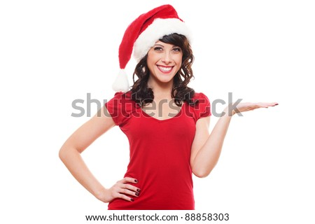 excited santa girl presenting something on open hand palm. isolated on white background