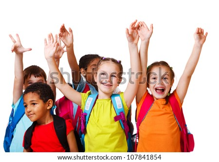 Excited school aged kids with backpacks