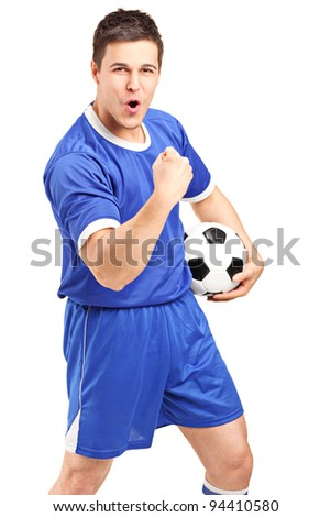 Excited sport fan holding a football and gesturing isolated on white background