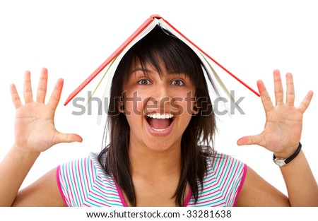 excited student with a notebook on top of her head isolated