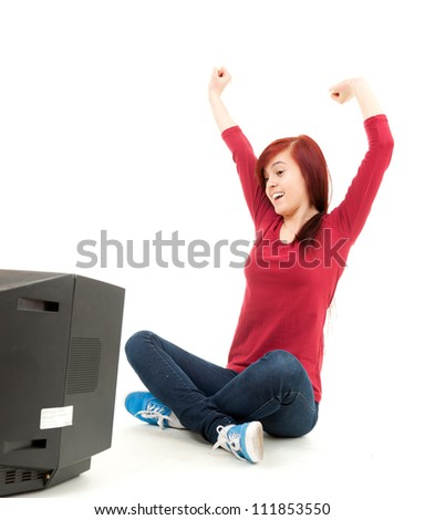 excited teenage girl watching tv, white background