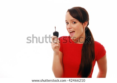 Excited teenager holding a car key
