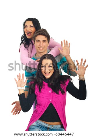Excited three friends standing in a row and showing their palms isolated on white background
