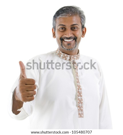 Excited thumb up Indian man in traditional costume kurta dhoti isolated on white background
