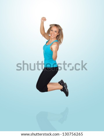 Excited Woman Jumping Isolated On Blue Background