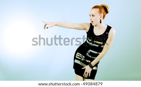 stock-photo-excited-woman-pointing-at-something-49084879.jpg
