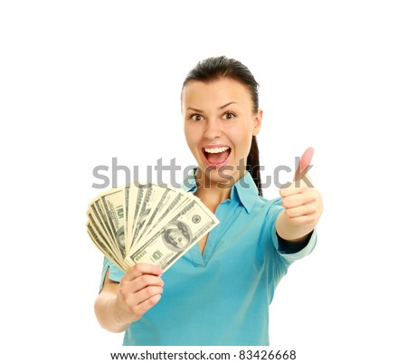 Excited woman with handful of money giving thumbs up isolated on white background
