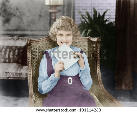 Excited woman with letter