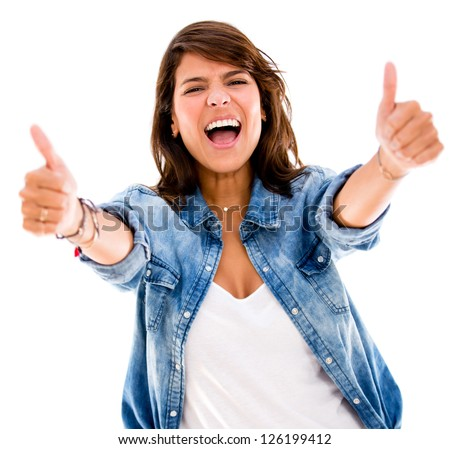 Excited woman with thumbs up - isolated over a white backgorund