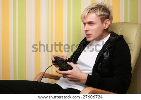 stock photo excited young adult playing video game 27606724 Starring Nude Celebrities Leelee Sobieski