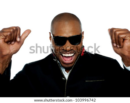 Excited young african man shouting in excitement with arms up. Closeup