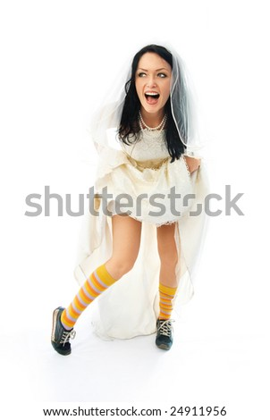 excited young brunette bride wearing sporting shoes and colorful socks
