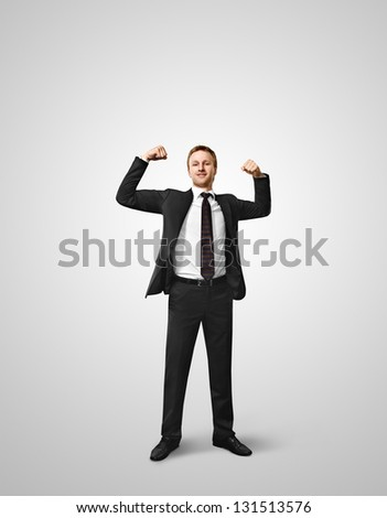 Excited young businessman celebrating victory on white background