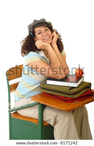 Excited young student at a desk with books and an apple