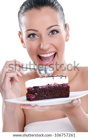 excited young woman eating tasty, chocolate cakes