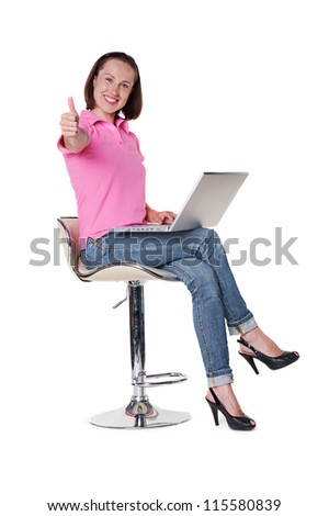 excited young woman holding laptop and showing thumbs up. isolated on white background
