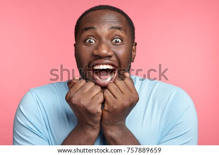Excitement and amazement. Positive male says wow, stares at camera with eyes full of happiness, finds out about winning present in lottery, can`t believe his good luck, being excited and stunned #757889659