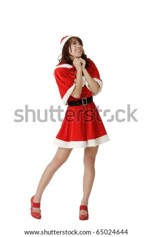 Exciting Christmas woman praying, full length portrait isolated over white.