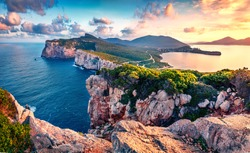 Exciting morning view of Caccia cape. Nice spring sunrise on Sardinia island, Italy, Europe. Great morning seascape of Mediterranean sea. Beauty of nature concept background.