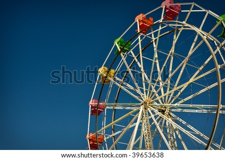 Exciting red, pink, yellow ferris wheel