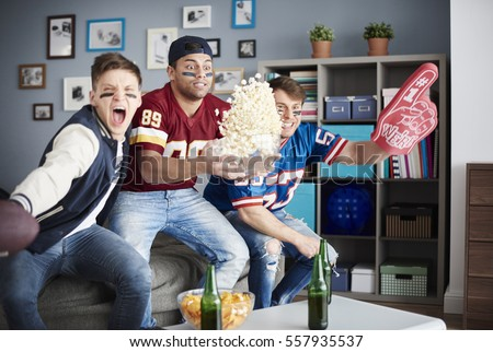 Exciting scene of American football supporters  #557935537