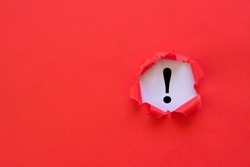 Exclamation mark concept. Torn red paper with exclamation mark on white background.