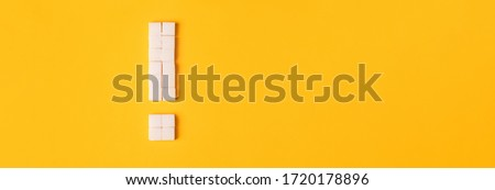 Exclamation mark made from sugar cubes. Concept - danger of abuse of sugar,overweight, diabetes. Stock photo ©
