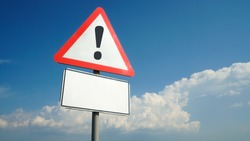 Exclamation mark on a road sign with a white nameplate background sky with clouds, warning, danger, attention