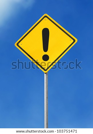exclamation yellow road sign on sky background