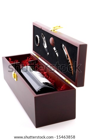 Exclusive red wine with bottle openers in a gift box as a closeup image isolated on white background