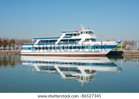 Excursion Boat:  An excursion boat used to tour the Cleveland, Ohio waterfront and portions of the Cuyahoga River is moored at it's home dock at the end of the tour season - stock photo