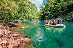 Excursions on inflatable boats along the river Tara. Splendid summer morning in Tara canyon, Montenegro, Europe. Beautiful world of Mediterranean countries. Active tourism concept background.