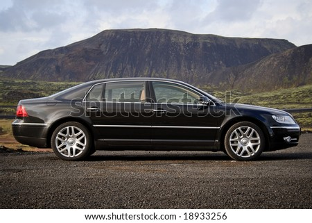 Executive black business sedan side view